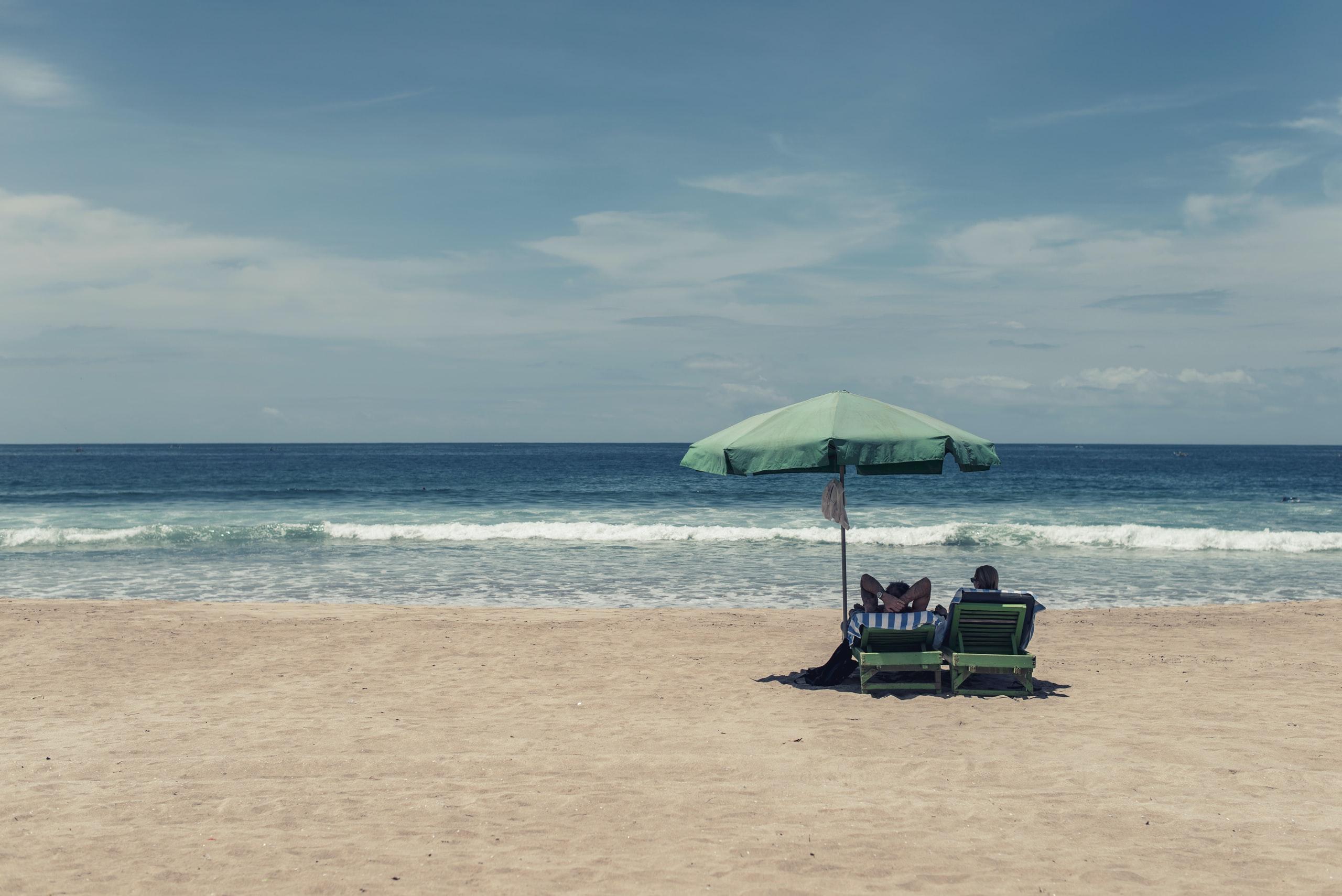 Couple sit on the beach
