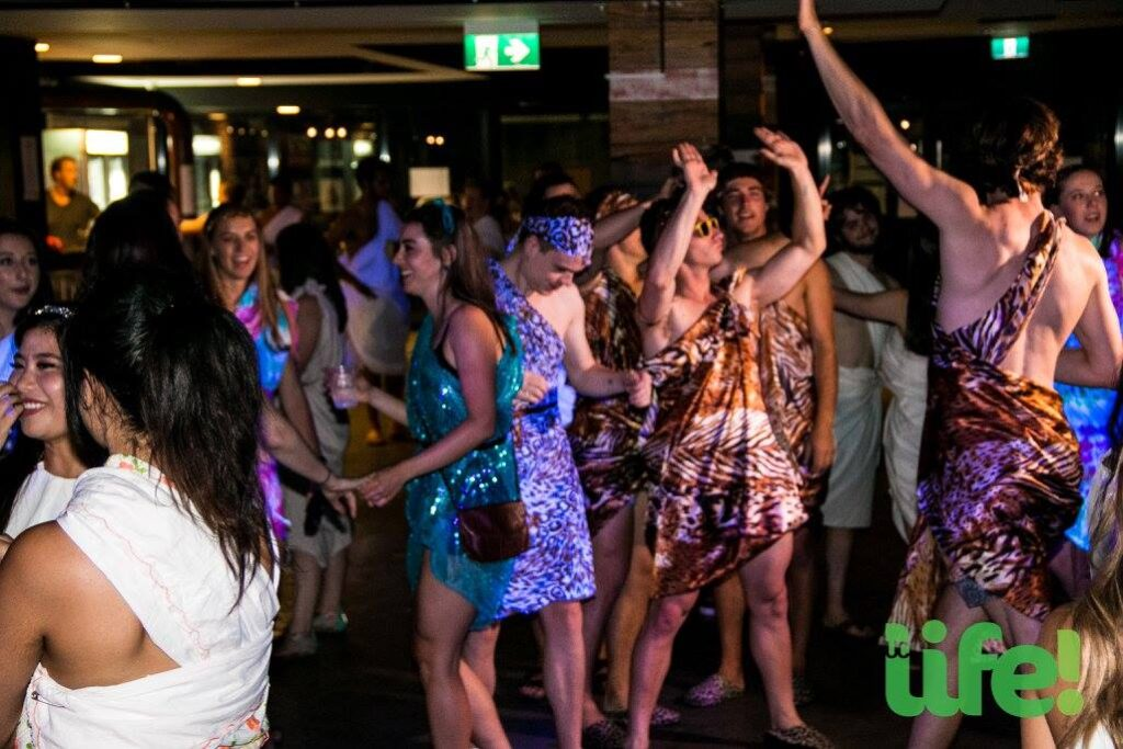 Students dance at the UC Toga Party.