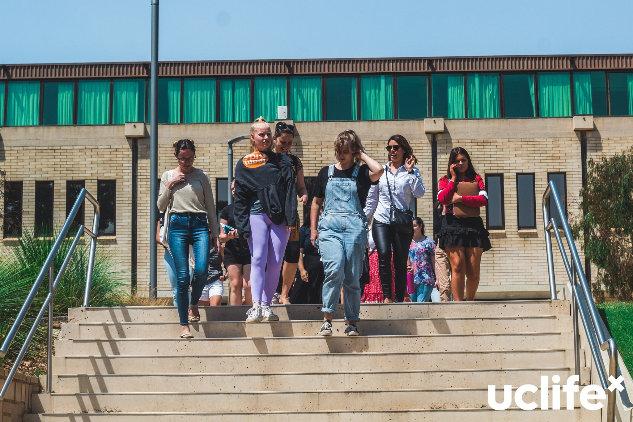 New students walk down stairs towards UC concourse to join UC O-week activities