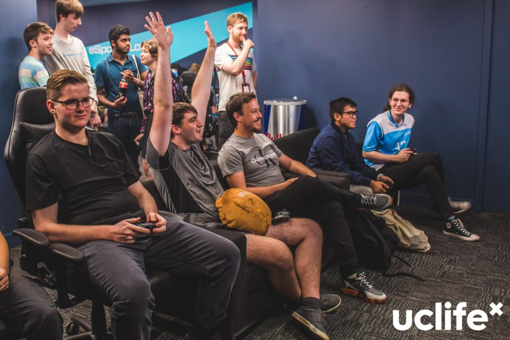 Student celebrates win in the UC E-Sports lounge