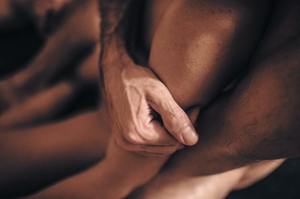 Man grasps onto a womens arm