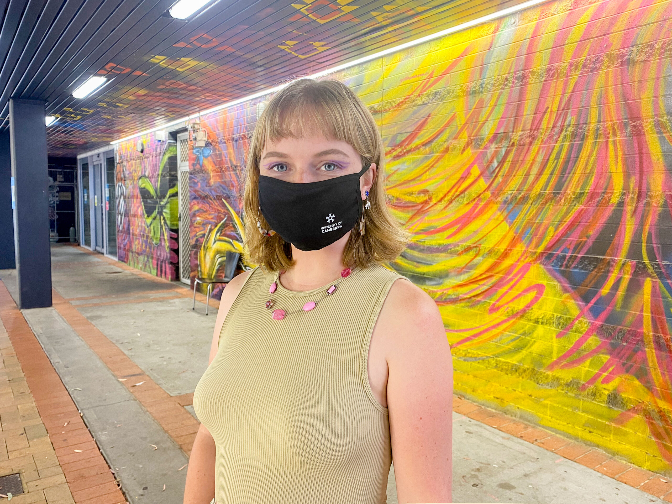 Woman in UC mask