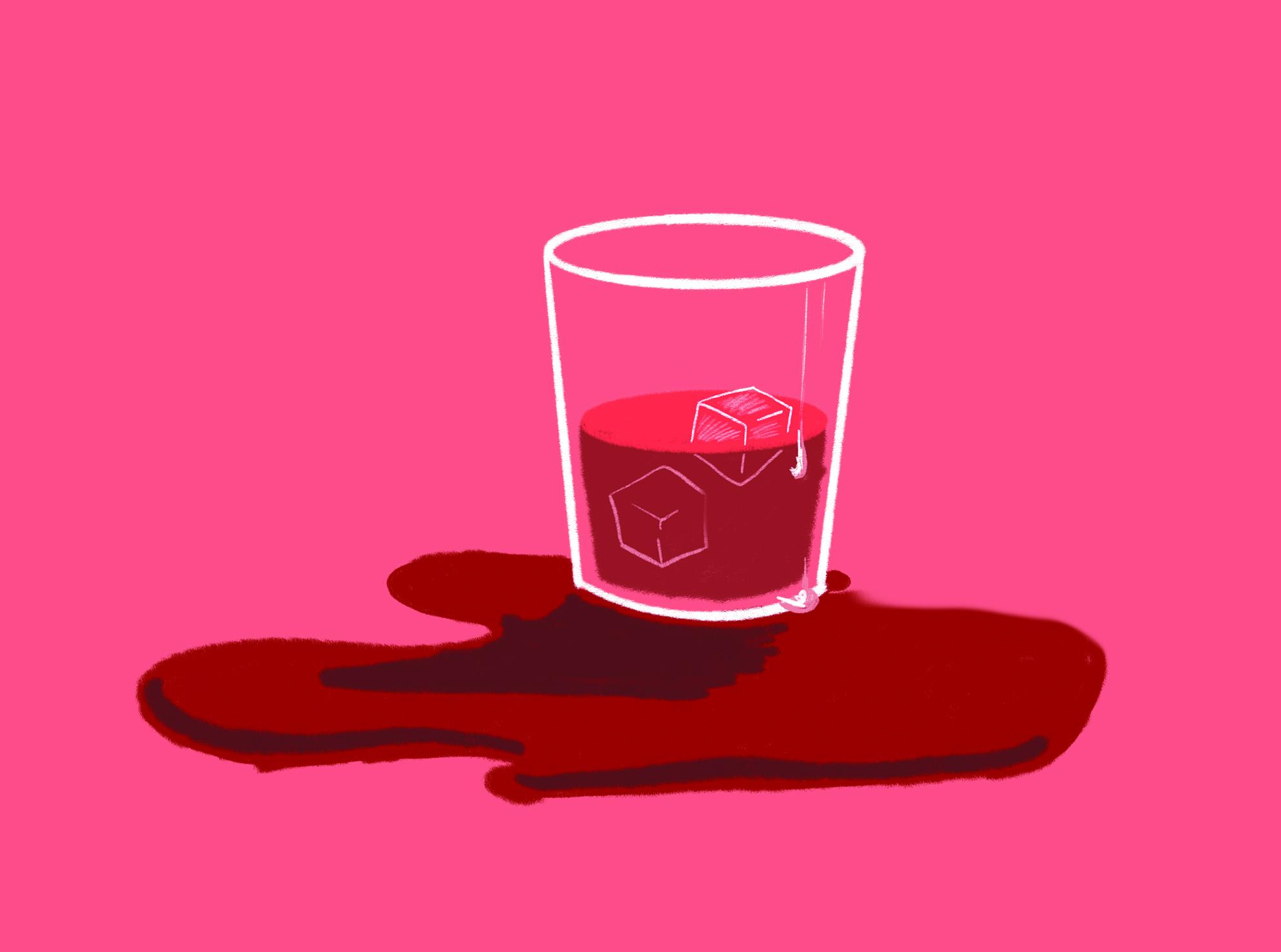 Spilt red liquid from a glass