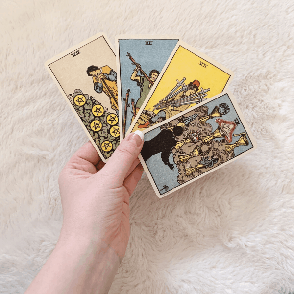 Four Sevens, Three Sevens, Two Sevens in a Tarot reading