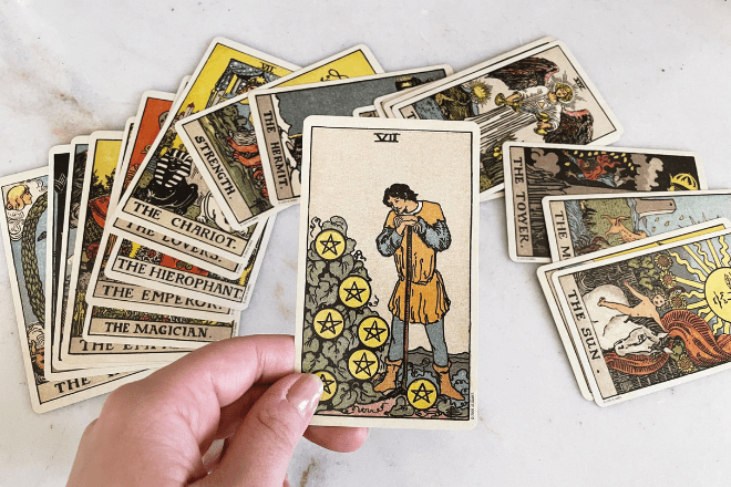 8 Seven of Pentacles Tarot Meanings: Love, Outcomes, Feelings & More!
