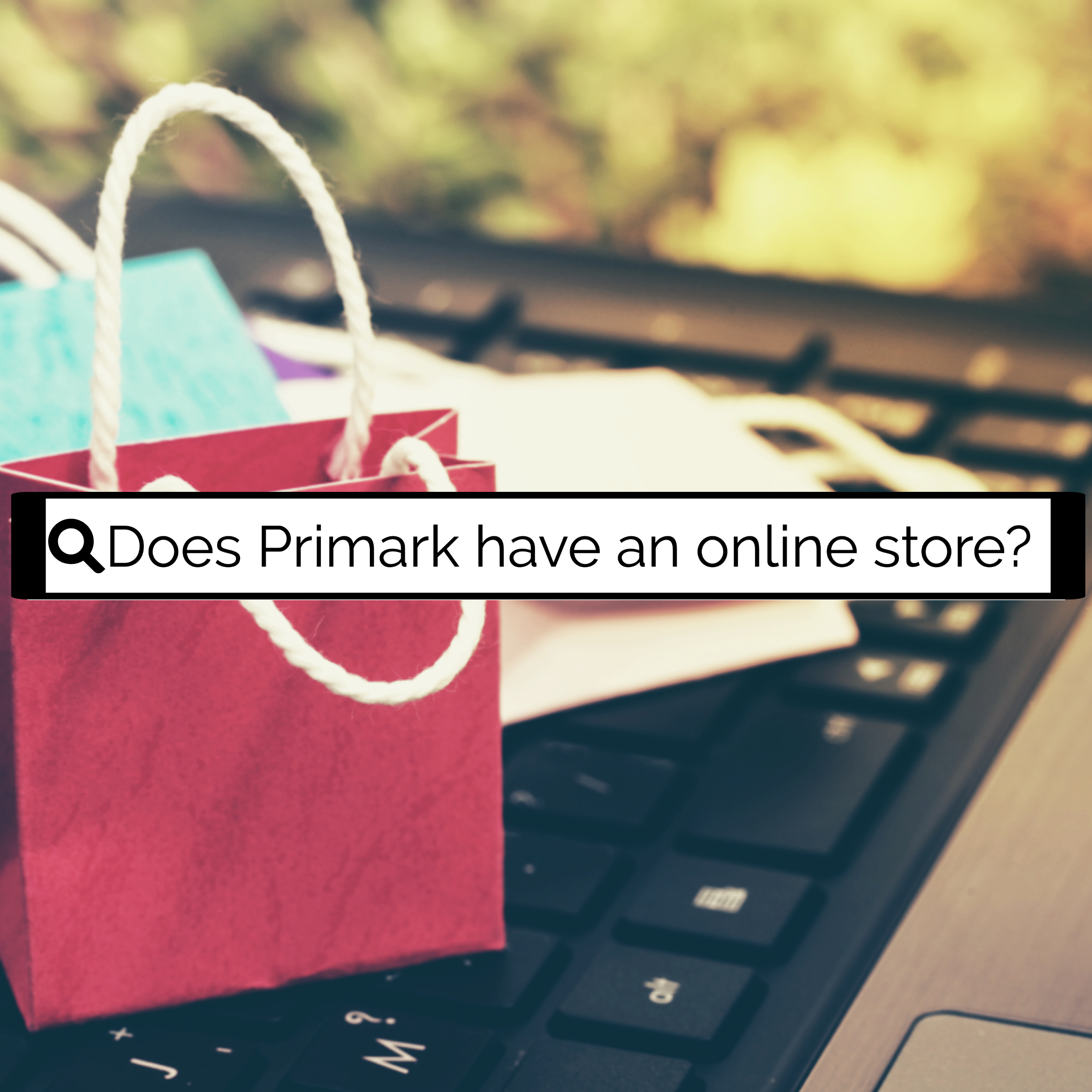 """Shopping bags ontop of keyboard with search bar """"Does Primark have an online store?"""""""