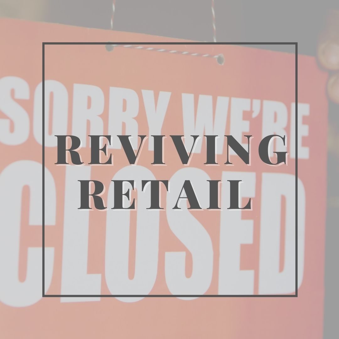 """Reviving Retail text infront of """"sorry we're closed"""" sign"""