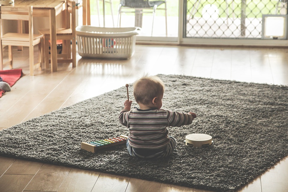 Baby playing musical instruments to support development