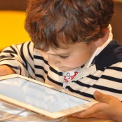 child-using-tablet