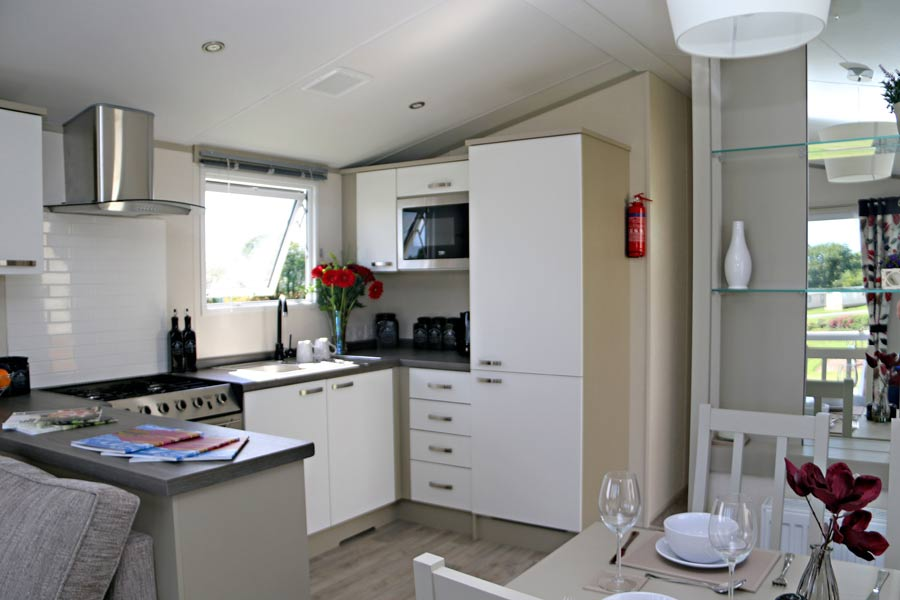 Spacious kitchen with integrated cooker, fridge/freezer and microwave.