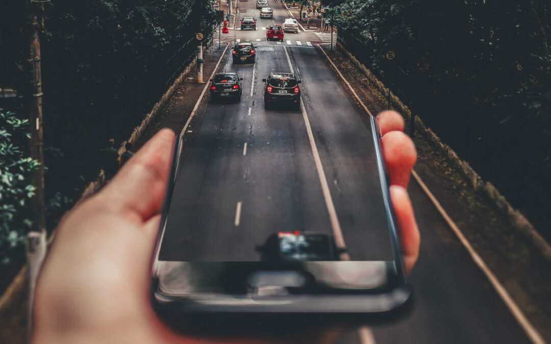 Smartphone merging into busy road