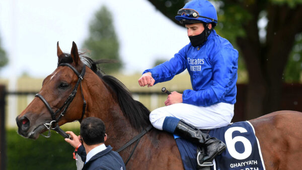 William Buick celebrates on board Ghaiyyath after winning the Group 1 Coronation Cup at Newmarket.