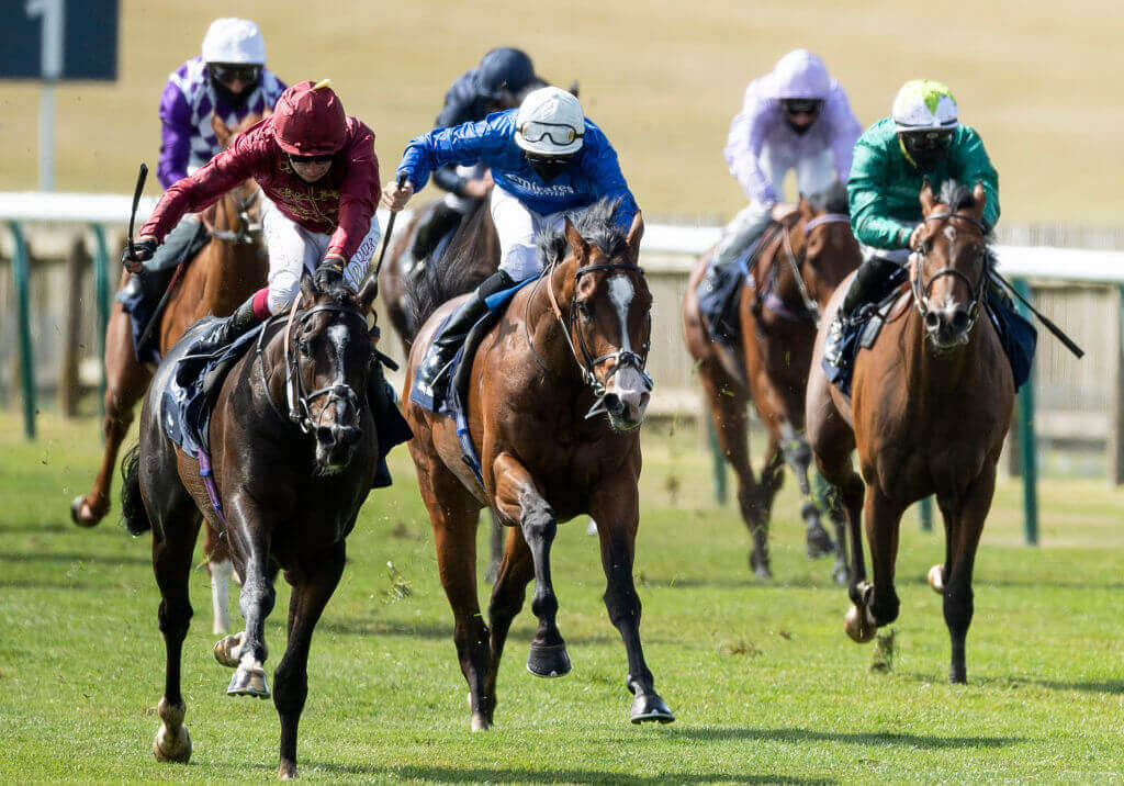 Kameko (l) ridde by Oisin Murphy beats Pinatubo (r) to win the 2000 Guineas at Newmarket.