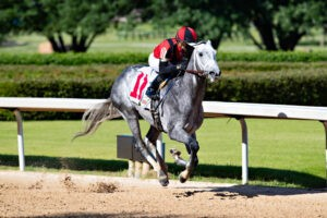 Rushie leads down the stretch to win Race 10 at Oaklawn on Derby Day.