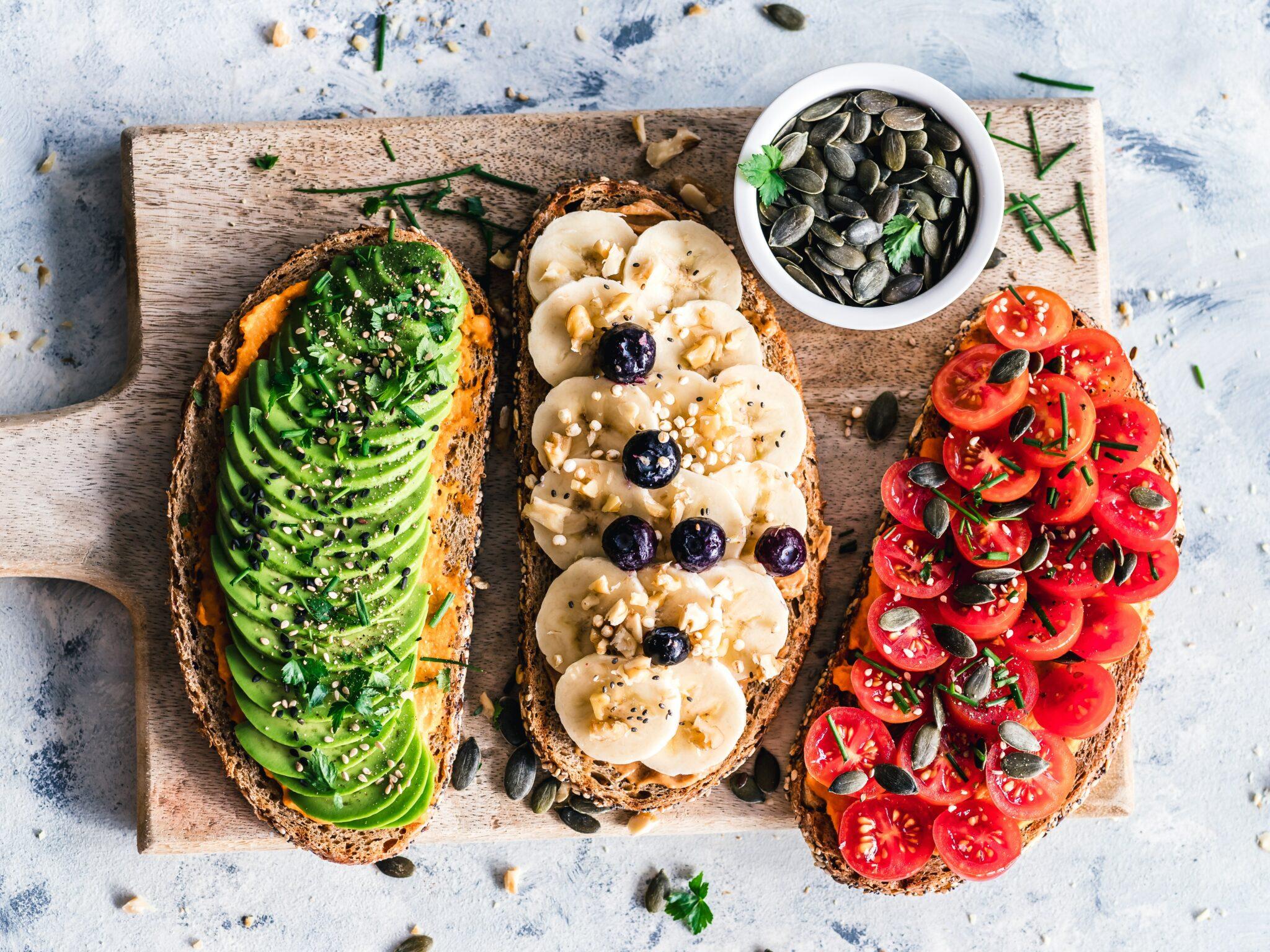 avocado, banana and tomatos on bread