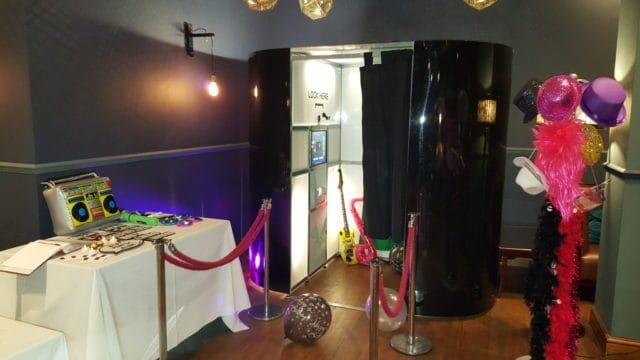 Black oval booth for a birthday party