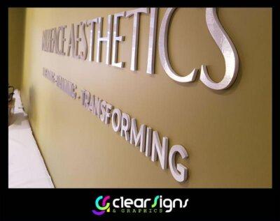 Brushed Aluminium Finish - Flush Fitted PVC Wall Logo (1) (1)