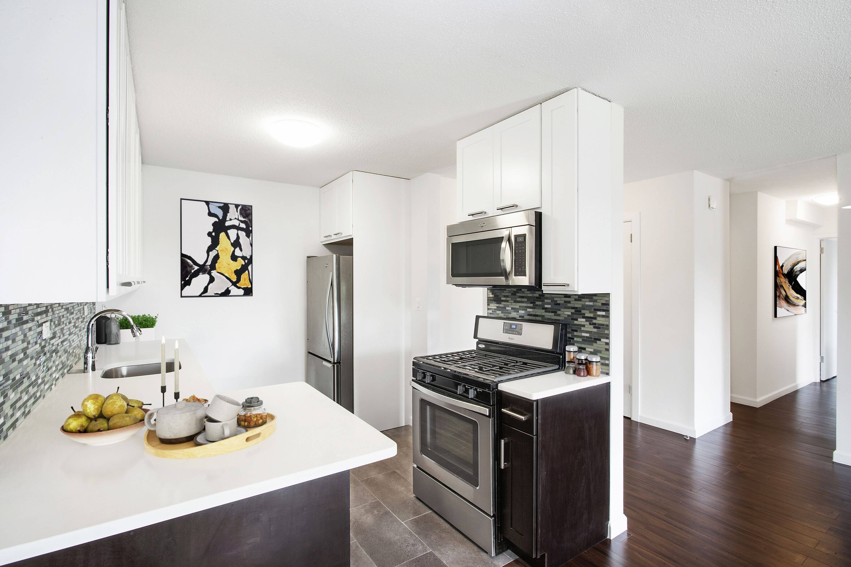 The modern kitchens at The Promenade, Located in Marble Hill at 150 west 225th street, have stainless steel Bosch & Fisher Paykel appliances.