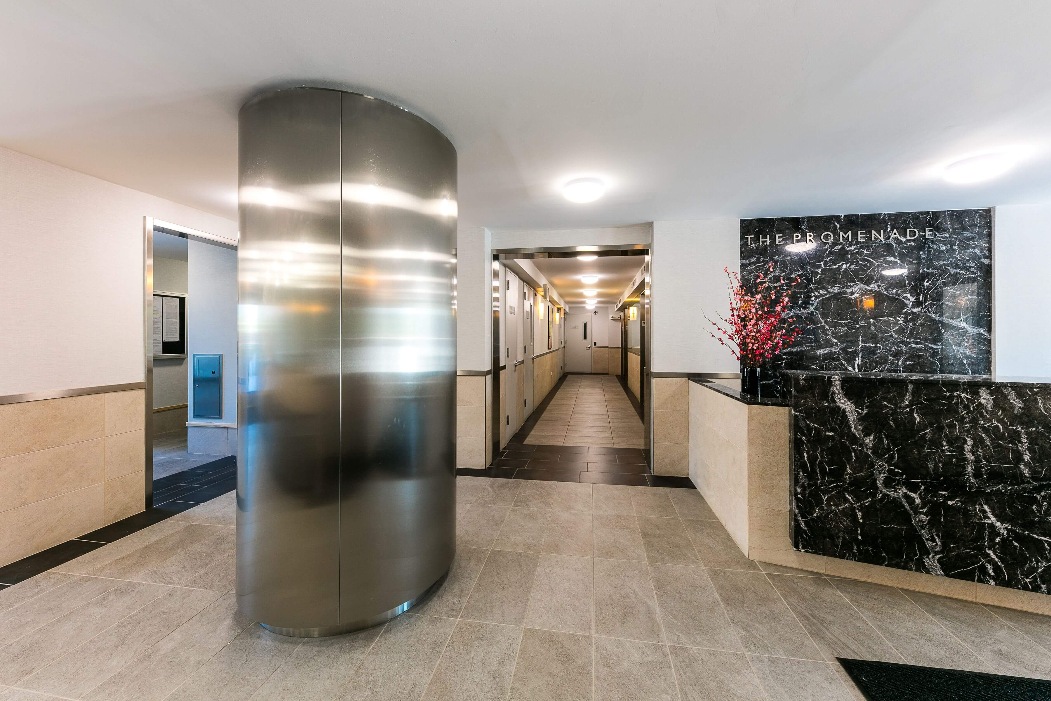 The Lobby at The Promenade, 150 West 225th street, has modern Finishes, including Marble & stainless steel.
