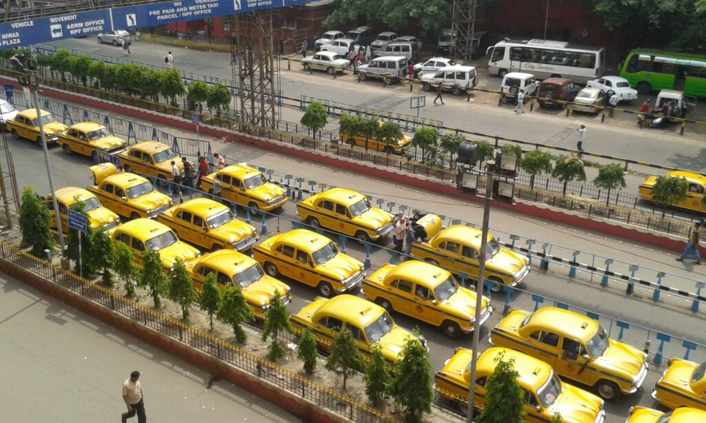 Yellow ambassador taxis from howrah station in kolkata.