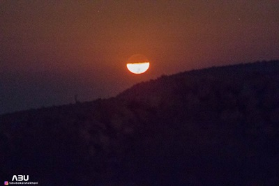 First quarter moon setting behind the mountains of Badro Jabal, Sindh