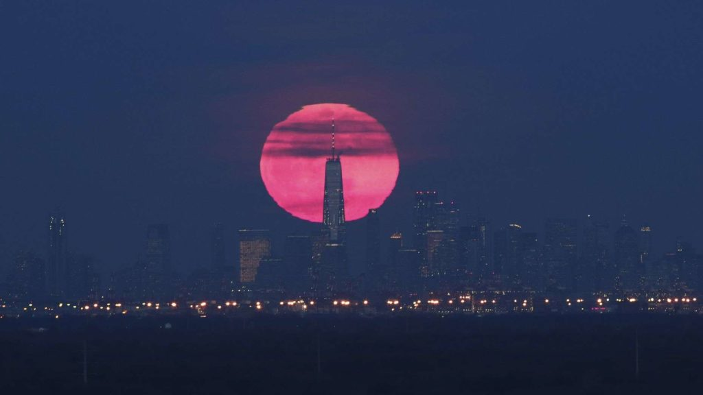 The super snow moon (called as such for appearing in winter) is rising behind the iconic coastline of Manhattan in New York City.