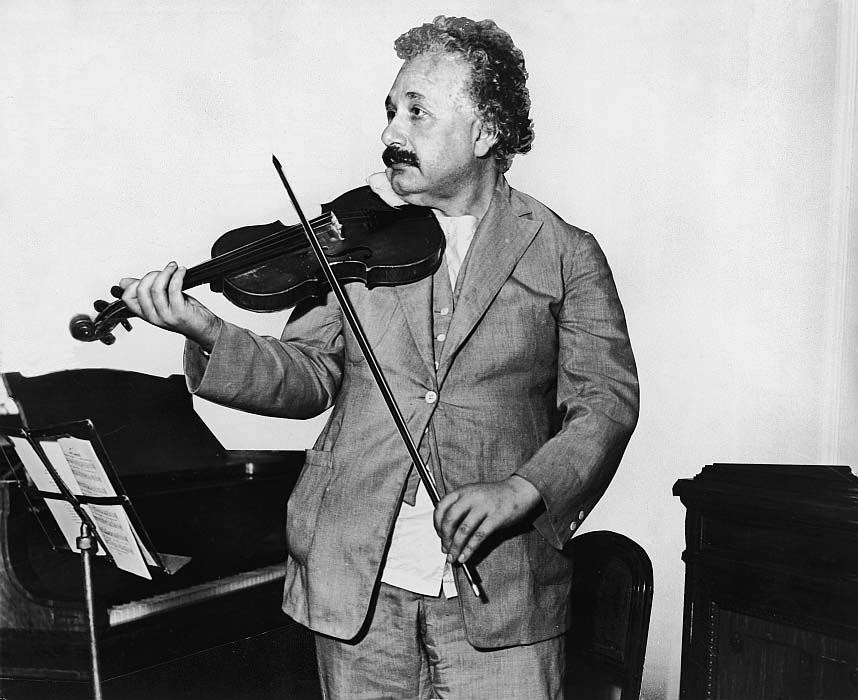 This heavily retouched photograph shows German-Swiss-American mathematical physicist Albert Einstein (1879 - 1955) as he plays the violin in the music room of the S.S. Belgenland en route to California, 1931. (Photo by Keystone/Getty Images