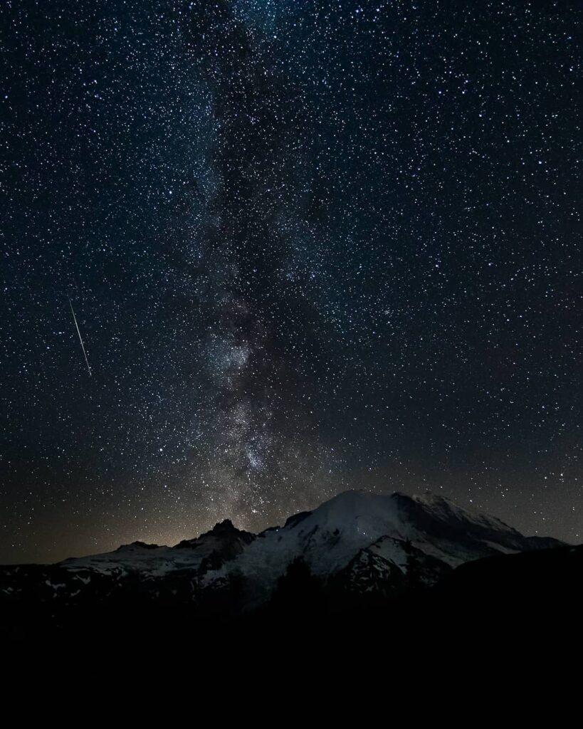 Mount Rainier serving as the perfect backdrop for the meteor shower that can be seen along with the Milky Way
