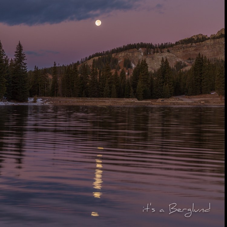 The bright moon above overlooking the waters in  The West Elks AVA