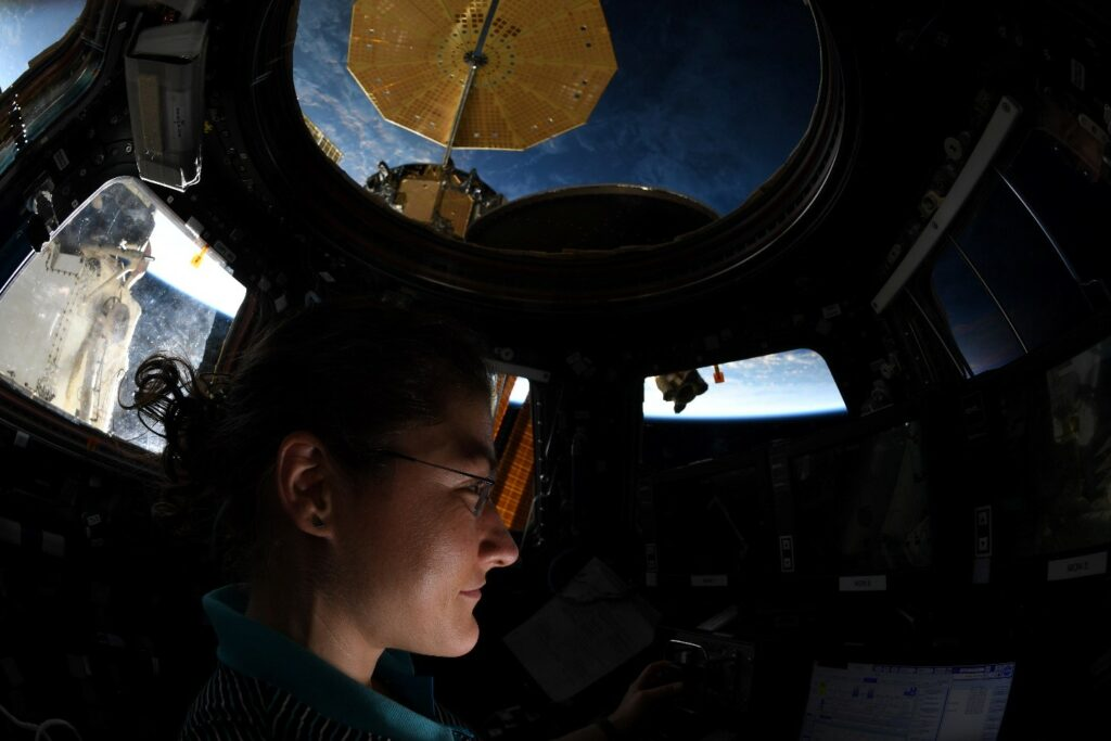 NASA astronaut Christina Koch makes observations from the International space Station's cupola.