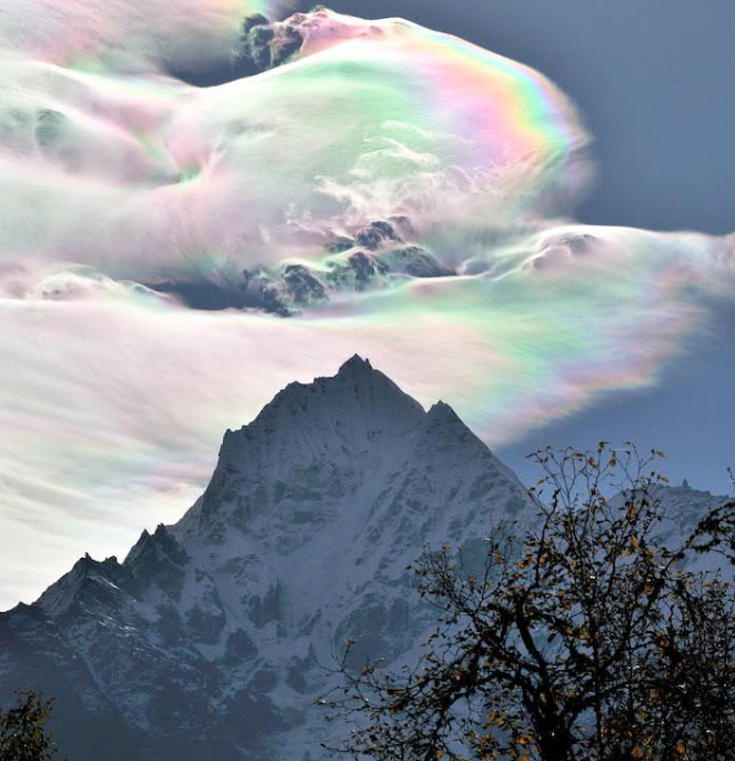 The rare 'Fire Rainbow' seen here above a mountain. (Source: Oleg Bartunove via APOD)