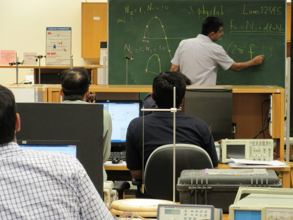Dr. Sabieh in a classroom. He is of the opinion that there is a need for equivalence and mutual respect across systems.