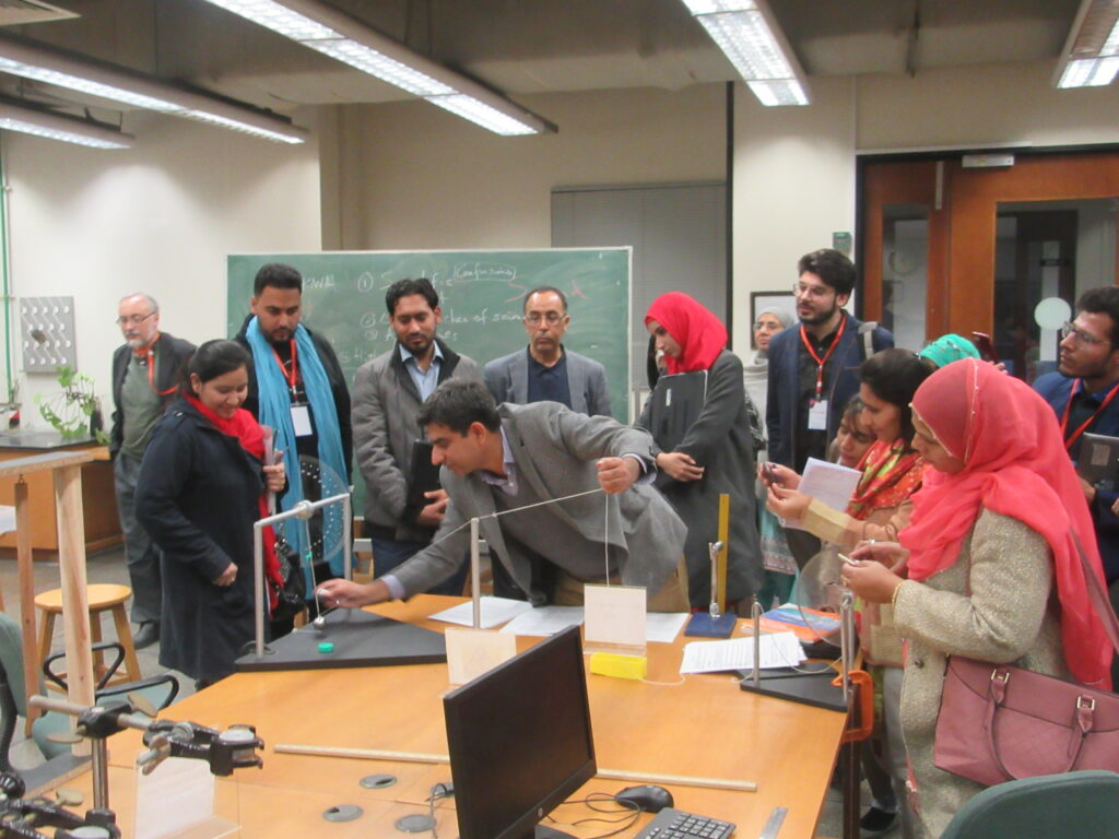 Dr. Sabieh demonstrating the motion of a pendulum to keen visitors. According to him, there are aspects of certain educational disciplines that are not possible online.
