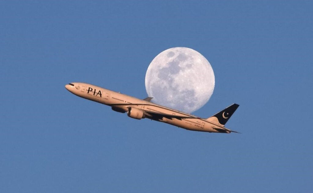 Picture of the Moon, photobombed by a passenger plane taken from Lahore by Mian Mateen