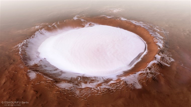 A spectacular shot of the Korolev Crater, a dish-shaped basin on the broad plain that surrounds the Martian north pole. Image Credit: ESA/DLR