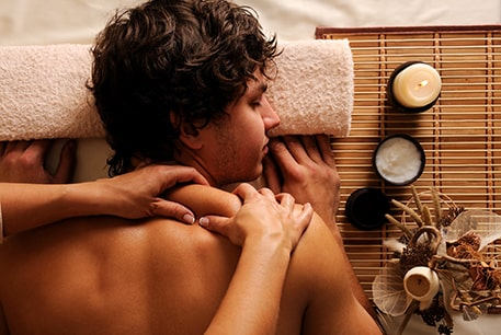 Man getting deep tissue massage therapy