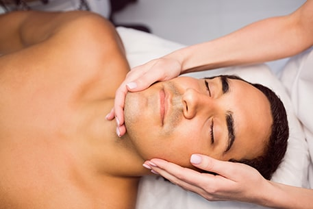Man getting Indian head massage therapy
