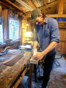 Murphy at work in the Gateway Gurdy workshop