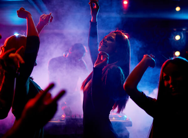 Girls dancing in a lively night club. Entertainment licences are required, as well as alcohol.