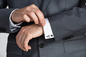 Cheating. Man with card up his sleeve. Dishonesty