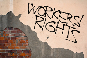 Graffiti of Workers Rights on wall. Uber are trying to avoid paying the minimum wager to their drivers.