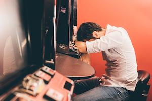 Problem Gambling, Problem Gambler sitting at FOBT machine