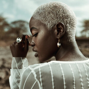 Model wearing zig zag earrings and ring