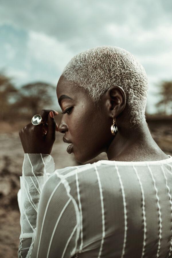 Model wearing zig zag earrings and ring