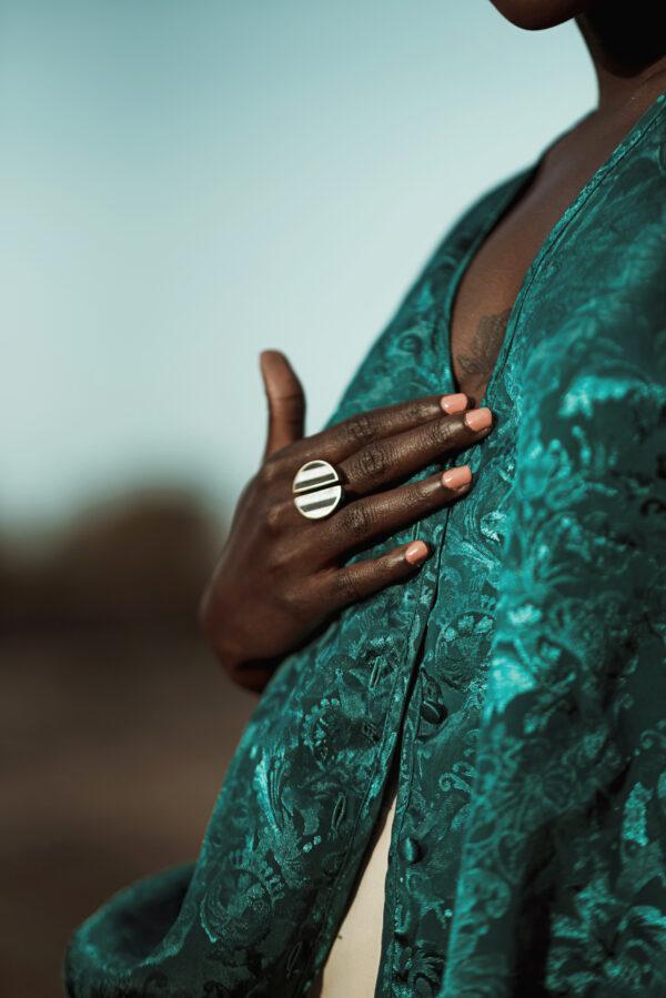 Model wearing striped split ring