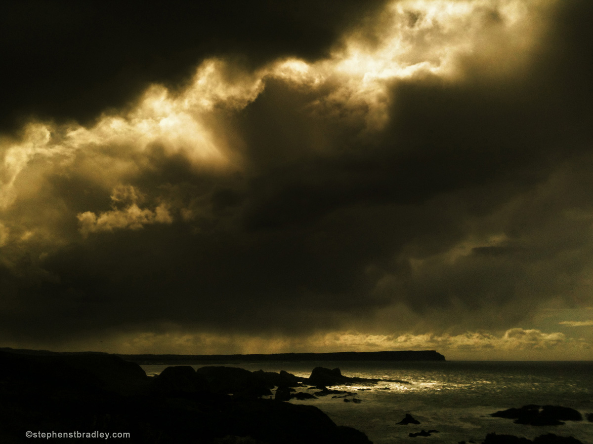Commercial Photographer Atlanta landscape photo of storm clouds near Ballintoy, Northern Ireland - photo 2413.