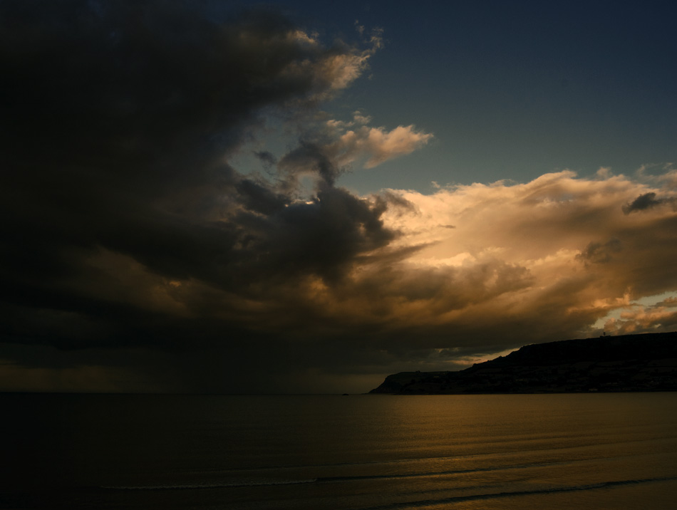 Landscape photograph of rain clouds over Irish Sea from Carnlough, Northern Ireland, by Stephen Bradley photographer - photograph 2546 photo icon.
