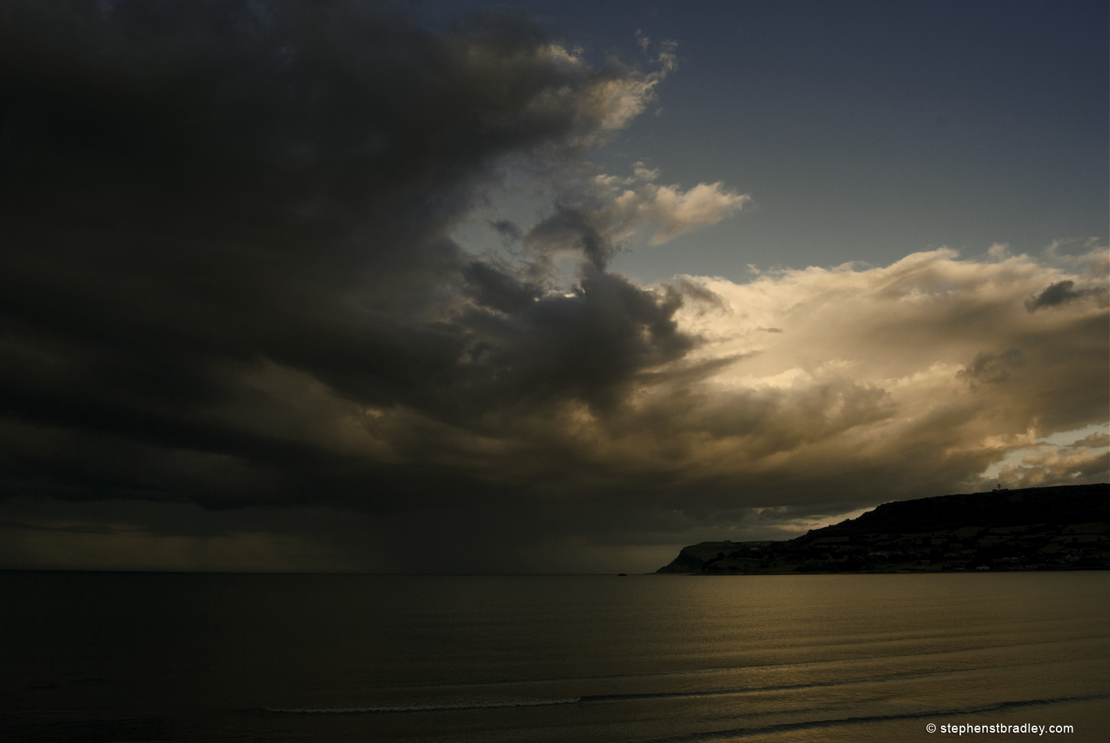 Landscape photograph of rain clouds over Irish Sea from Carnlough, Northern Ireland, by Stephen Bradley photographer - photograph 2546.