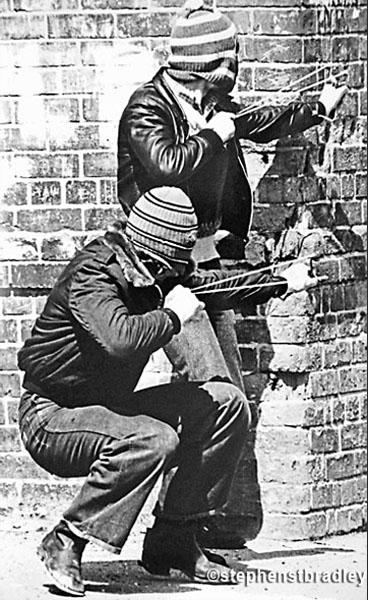 Editorial photographer Dublin Ireland, rioters firing catapults, Belfast, Ireland - portfolio photo 1.