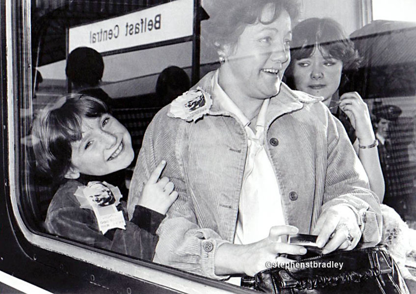 Mother and children on train going to see Pope John Paul, Central Station, Belfast, by Stephen S T Bradley, editorial, commercial, PR and advertising photographer, Dublin, Ireland